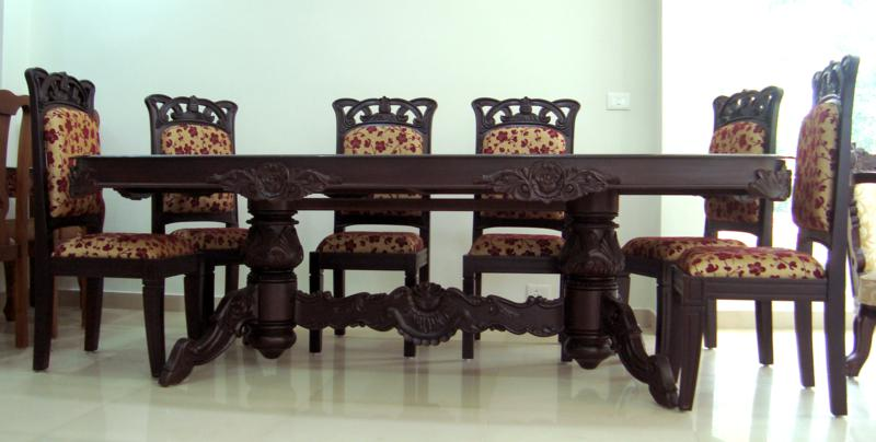 Dining table wooden dining table designs kerala for Innovative dining table designs