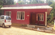 1.15 acre land with  house for sale near Varadoor.